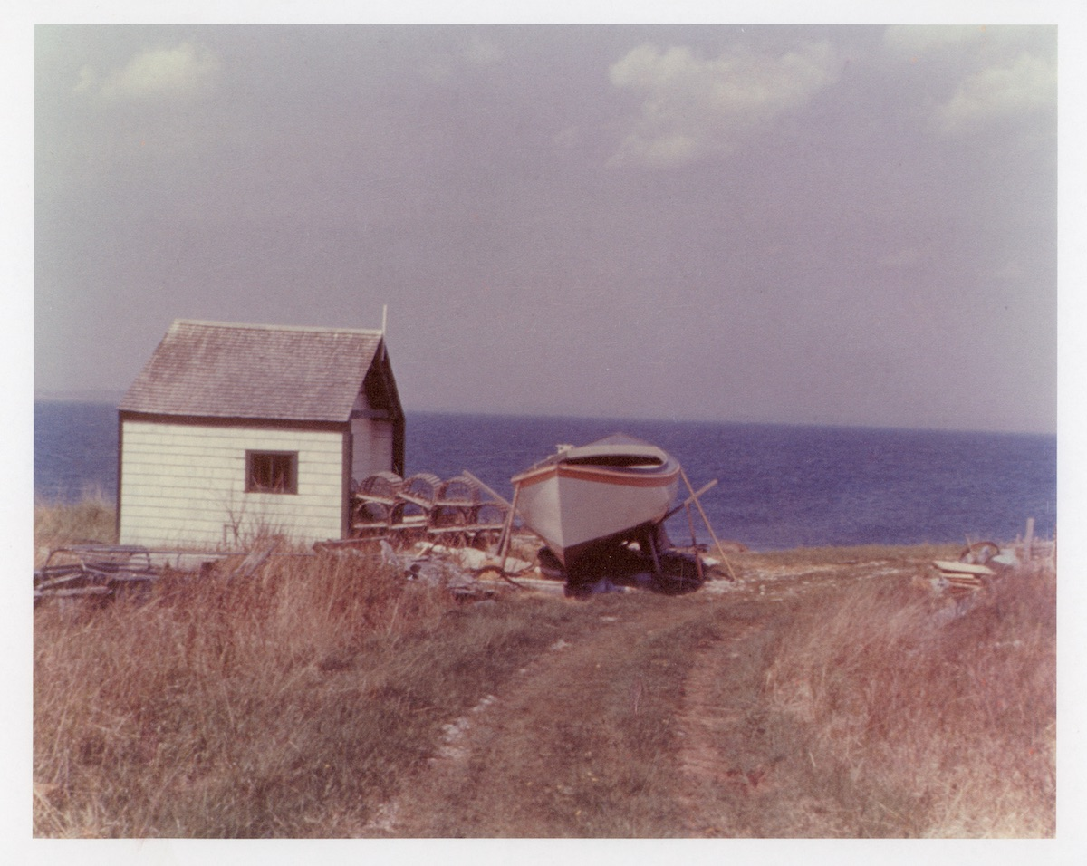 "Coast Guard "" Peapod"" boat near hut on Baker Island"